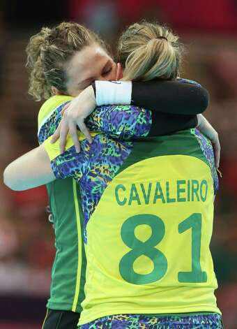 LONDON, ENGLAND - JULY 28:  Chana Masson hugs Deonise Cavaleiro of Brazil after winning 24-23 in the Women's Handball preliminaries Group A - Match 3 between Croatia and Brazil on Day 1 of the London 2012 Olympic Games at the Copper Box on July 28, 2012 in London, England.  (Photo by Jeff Gross/Getty Images) Photo: Jeff Gross, Getty Images / 2012 Getty Images