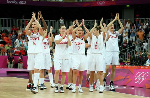LONDON, ENGLAND - JULY 28:  Turkey celebrate their 72-50 win over Angola during Women's Basketball on Day 1 of the London 2012 Olympic Games at the Basketball Arena on July 28, 2012 in London, England.  (Photo by Christian Petersen/Getty Images) Photo: Christian Petersen, Getty Images / 2012 Getty Images