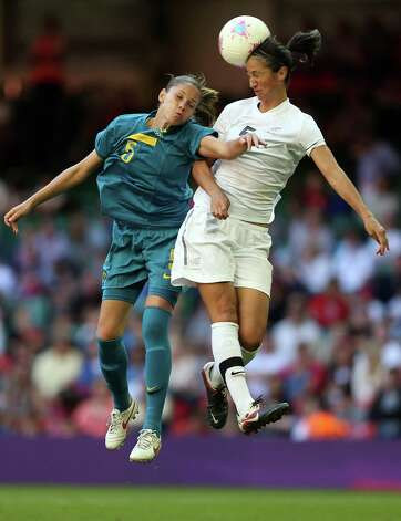 CARDIFF, WALES - JULY 28:  Erika of Brazil challenges for a header with Abby Erceg of New Zealand during the Women's Football first round Group E match between New Zealand and Brazil on Day 1 of the London 2012 Olympic Games at Millennium Stadium on July 28, 2012 in Cardiff, Wales.  (Photo by Julian Finney/Getty Images) Photo: Julian Finney, Getty Images / 2012 Getty Images
