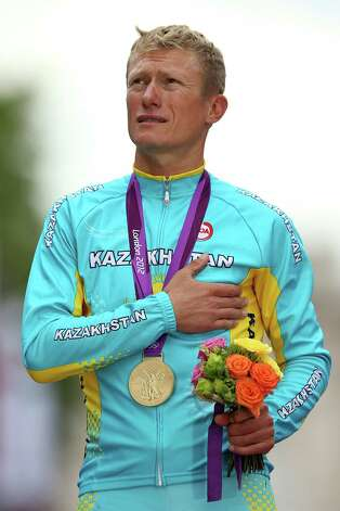 LONDON, ENGLAND - JULY 28:  Gold medallist Alexandr Vinokurov of Kazakhstan celebrates during the Victory Ceremony for the Men's Road Race Road Cycling on day 1 of the London 2012 Olympic Games on July 28, 2012 in London, England.  (Photo by Ezra Shaw/Getty Images) Photo: Ezra Shaw, Getty Images / 2012 Getty Images