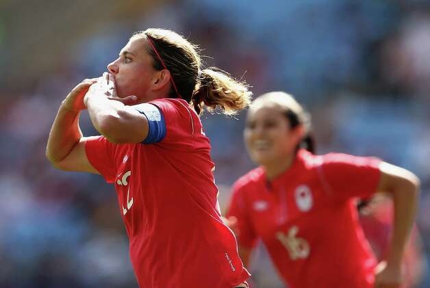 COVENTRY, ENGLAND - JULY 28:  Christine Sinclair of Canada celebrates scoring a goal during the Women's Football first round Group F Match of the London 2012 Olympic Games between Canada and South Africa,at City of Coventry Stadium on July 28, 2012 in Coventry, England.  (Photo by Quinn Rooney/Getty Images) Photo: Quinn Rooney, Getty Images / 2012 Getty Images