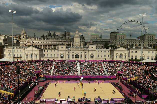 LONDON, ENGLAND - JULY 28: A general view during the Men's Beach Volleyball Preliminary Round on Day 1 of the London 2012 Olympic Games at Horse Guards Parade on July 28, 2012 in London, England.  (Photo by Ryan Pierse/Getty Images) Photo: Ryan Pierse, Getty Images / 2012 Getty Images
