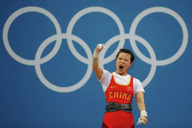 LONDON, ENGLAND - JULY 28:  Mingjuan Wang of China celebrates after a lift in the Women's 48kg Group A weightlifting on Day 1 of the London 2012 Olympic Games at ExCeL on July 28, 2012 in London, England.  (Photo by Laurence Griffiths/Getty Images) Photo: Laurence Griffiths, Getty Images / 2012 Getty Images