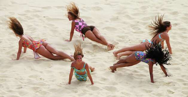 LONDON, ENGLAND - JULY 28:  Cheerleaders perform during Women's Beach Volleyball match between China and Russia on Day 1 of the London 2012 Olympic Games at Horse Guards Parade on July 28, 2012 in London, England.  (Photo by Ryan Pierse/Getty Images) Photo: Ryan Pierse, Getty Images / 2012 Getty Images
