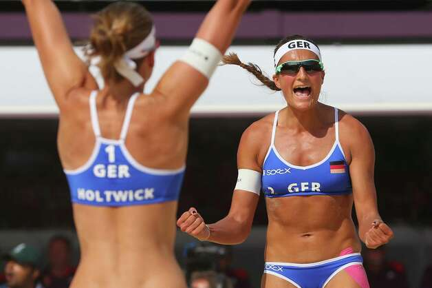LONDON, ENGLAND - JULY 28:  Katrin Holtwick (L) and Ilka Semmler of Germany a point during the Women's Beach Volleyball match between Germany and Czech Republic on Day 1 of the London 2012 Olympic Games at Horse Guards Parade on July 28, 2012 in London, England.  (Photo by Alexander Hassenstein/Getty Images) Photo: Alexander Hassenstein, Getty Images / 2012 Getty Images