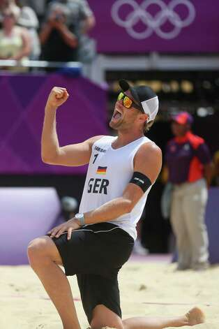 LONDON, ENGLAND - JULY 28: Julius Brink of Germany celebrates during the Men's Beach Volleyball match between Germany and Russia on Day 1 of the London 2012 Olympic Games at the Horse Guards Parade on July 28, 2012 in London, England.  (Photo by Alexander Hassenstein/Getty Images) Photo: Alexander Hassenstein, Getty Images / 2012 Getty Images