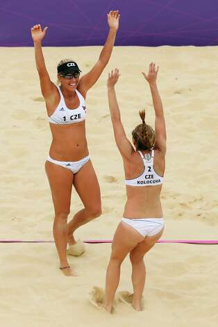 LONDON, ENGLAND - JULY 28:  Kristyna Kolocova and Marketa Slukova of Czech Republic celebrate their victory after the Women's Beach Volleyball Preliminary Round against Austria on Day 1 of the London 2012 Olympic Games at Horse Guards Parade on July 28, 2012 in London, England.  (Photo by Ryan Pierse/Getty Images) Photo: Ryan Pierse, Getty Images / 2012 Getty Images