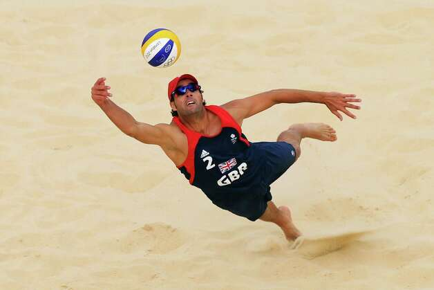 LONDON, ENGLAND - JULY 28: Steve Grotowski of Great Britain dives for the ball during the Men's Beach Volleyball Preliminary Round on Day 1 of the London 2012 Olympic Games at Horse Guards Parade on July 28, 2012 in London, England.  (Photo by Ryan Pierse/Getty Images) Photo: Ryan Pierse, Getty Images / 2012 Getty Images