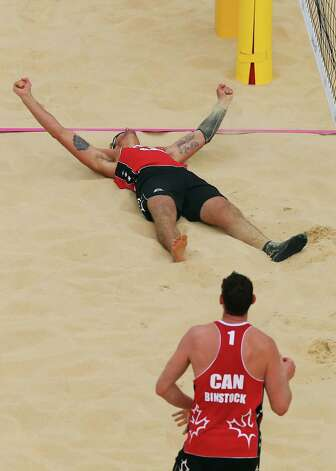 LONDON, ENGLAND - JULY 28:  Joshua Binstock #1 and Martin Reader of Canada celebrate their victory against Great Britain during the Men's Beach Volleyball Preliminary Round on Day 1 of the London 2012 Olympic Games at Horse Guards Parade on July 28, 2012 in London, England.  (Photo by Ryan Pierse/Getty Images) Photo: Ryan Pierse, Getty Images / 2012 Getty Images
