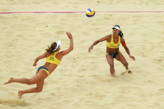 LONDON, ENGLAND - JULY 28:  Larissa Franca of Brazil dives for the ball as Juliana Silva is in action during the Women's Beach Volleyball Preliminary Round on Day 1 of the London 2012 Olympic Games at Horse Guards Parade on July 28, 2012 in London, England.  (Photo by Ryan Pierse/Getty Images) Photo: Ryan Pierse, Getty Images / 2012 Getty Images