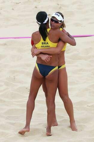 LONDON, ENGLAND - JULY 28:  Larissa Franca (R) and Juliana Silva of Brazil celebrate during the Women's Beach Volleyball Preliminary Round on Day 1 of the London 2012 Olympic Games at Horse Guards Parade on July 28, 2012 in London, England.  (Photo by Ryan Pierse/Getty Images) Photo: Ryan Pierse, Getty Images / 2012 Getty Images