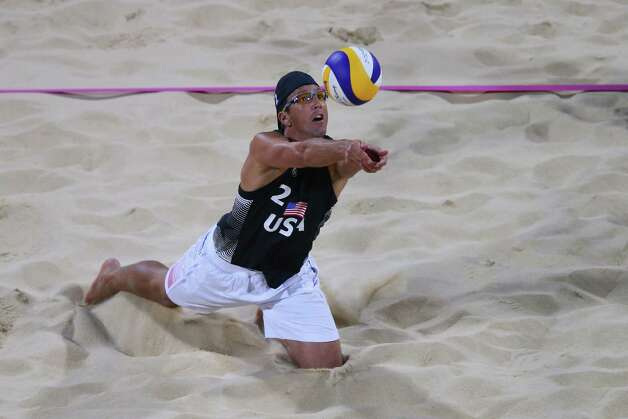 LONDON, ENGLAND - JULY 28:  Sean Rosenthal of the United States dives for the ball against South Africa during the Men's Beach Volleyball Preliminary Round on Day 1 of the London 2012 Olympic Games at Horse Guards Parade on July 28, 2012 in London, England.  (Photo by Ryan Pierse/Getty Images) Photo: Ryan Pierse, Getty Images / 2012 Getty Images