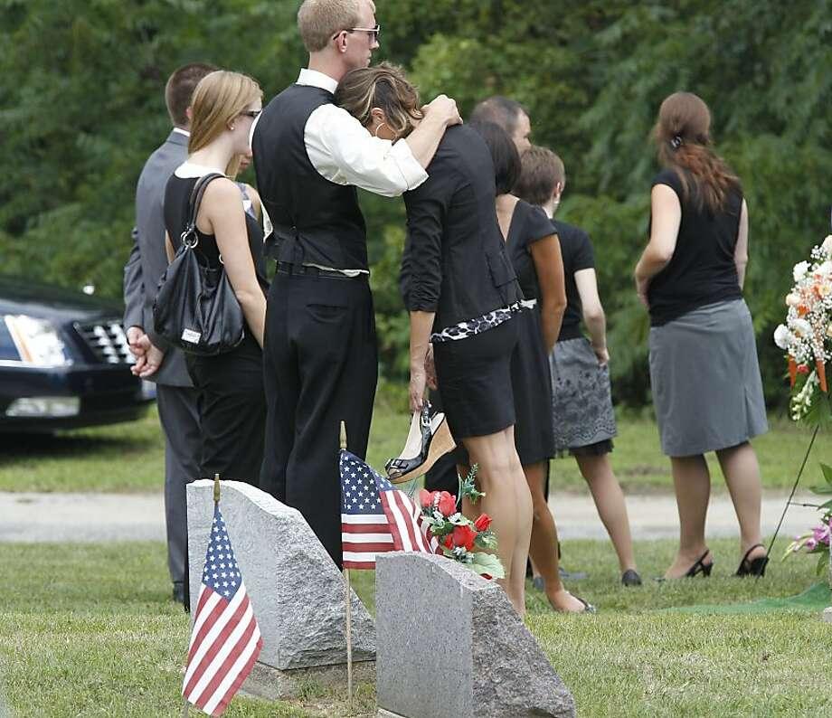 Funerals For Aurora Victims McQuinn, Ghawi