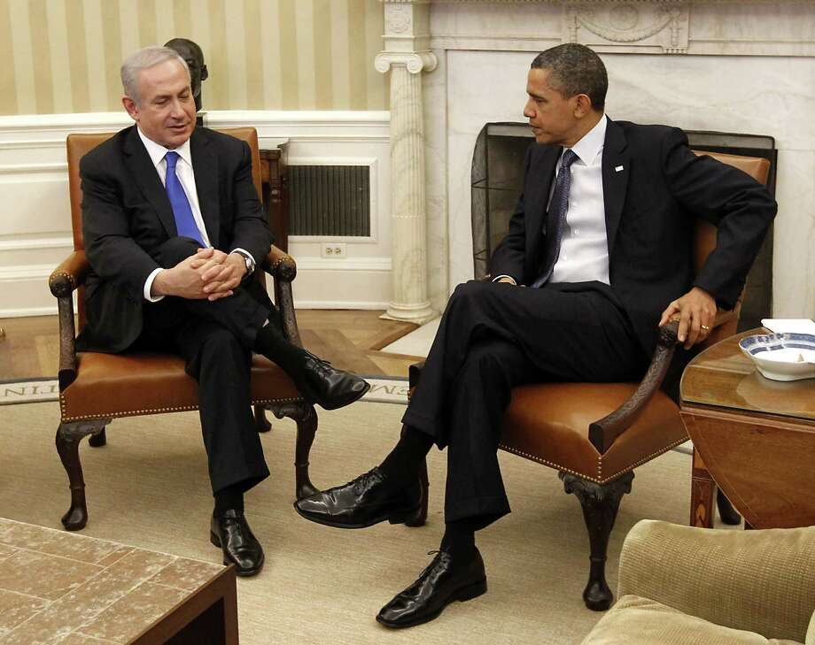 """FILE - In this March 5, 2012 file photo, President Barack Obama meets with Israeli Prime Minister Benjamin Netanyahu in the Oval Office of the White House in Washington. Washington's political praise has reached a crescendo ahead of Republican presidential candidate Mitt Romney's anticipated visit this weekend with Netanyahu in Israel. Their relationship has spanned decades, since their brief overlap in the 1970s at the Boston Consulting Group. Both worked as advisers for the firm early in their careers, before Romney co-founded his own private-equity firm. Romney in a speech this week called Israel """"one of our fondest friends,"""" and criticized President Barack Obama over what he called the administration's """"shabby treatment"""" of Israel. (AP Photo/Pablo Martinez Monsivais, File) Photo: Pablo Martinez Monsivais"""