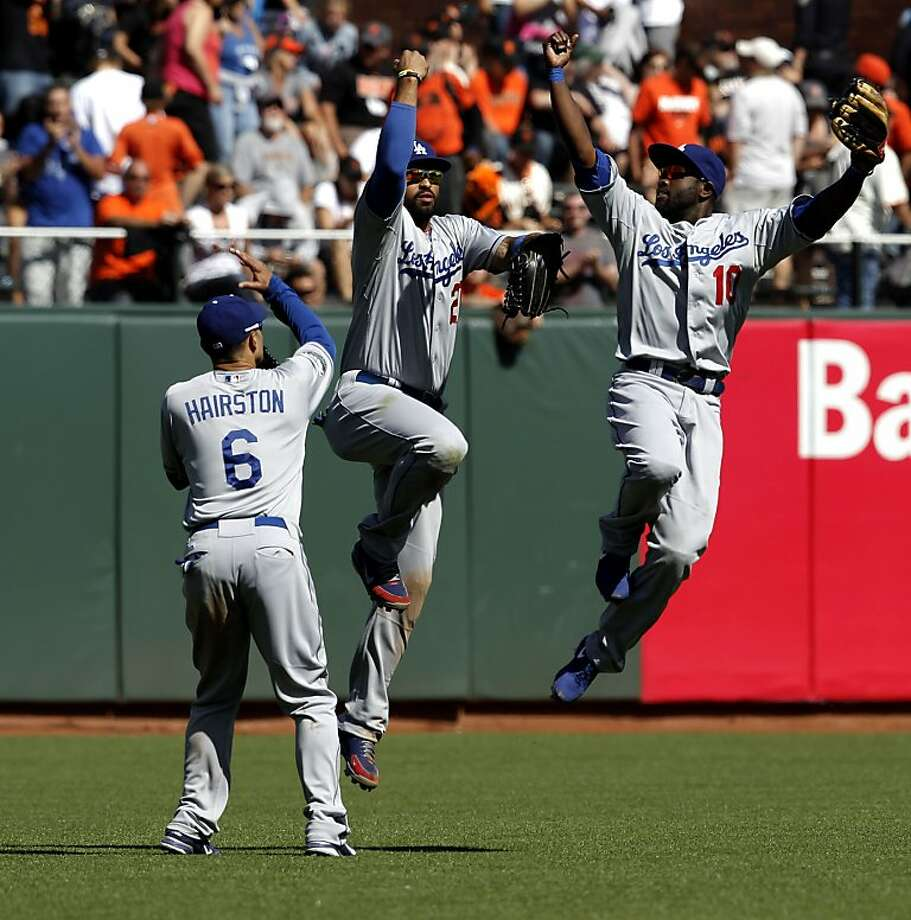 Dodger's Jerry Hairston, (6), Matt Kemp, (27) and Tiny Gwynn, (10), celebrate their win, as the San Francisco Giants fall to the Los Angeles Dodgers 10-0 at AT&T Park on Saturday July 28, 2012, in San Francisco, Calif. Photo: Michael Macor, The Chronicle