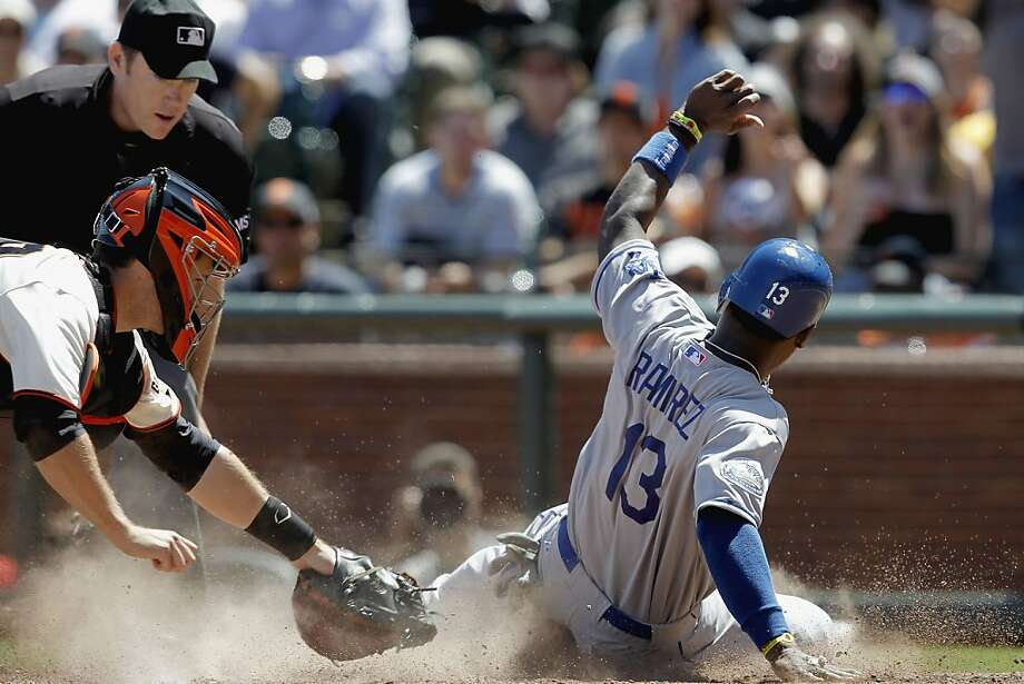 The Dodger's Hanley Ramirez, (13) gets around the tag from GIants' catcher, Buster Posey,(28) in the sixth inning on a Jerry Hairston triple, to make it 4-0 Los Angeles, as the San Francisco Giants fall to the Los Angeles Dodgers 10-0 at AT&T Park on Saturday July 28, 2012, in San Francisco, Calif. Photo: Michael Macor, The Chronicle