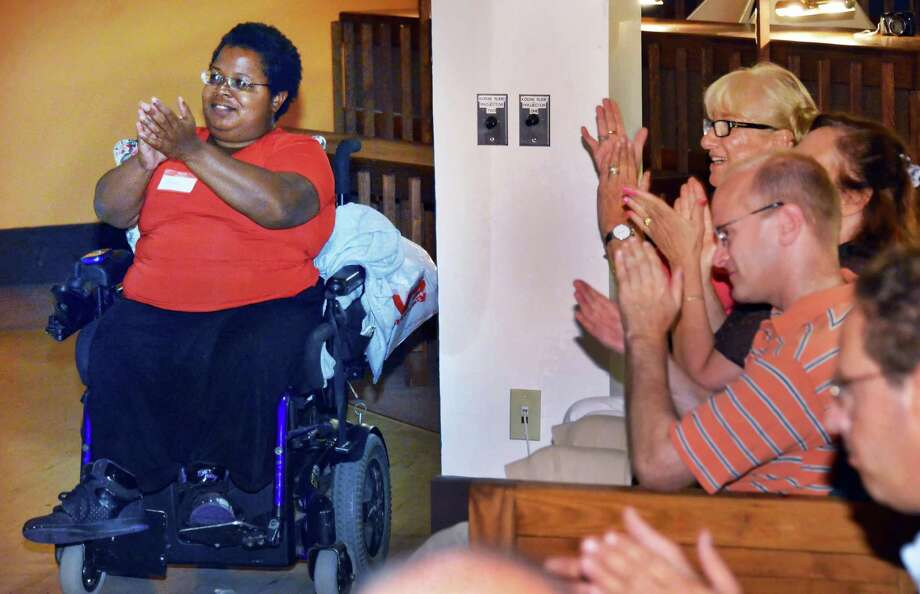 Self Advocacy Associations' Shameka Andrews, left,  of Albany applauds speakers  during an event to call attention to barriers to voting faced by persons with disabilities in Troy Saturday July 28, 2012. holds   (John Carl D'Annibale / Times Union) Photo: John Carl D'Annibale / 00018643A