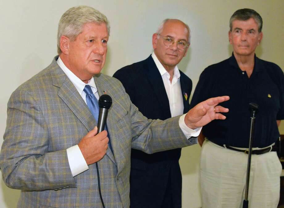 Speaking at an event to call attention to barriers to voting faced by persons with disabilities are , from left,  NYS Senator Roy McDonald, US Congressman Paul Tonko, and NYS Senator Neil Breslin in Troy Saturday July 28, 2012. holds   (John Carl D'Annibale / Times Union) Photo: John Carl D'Annibale / 00018643A