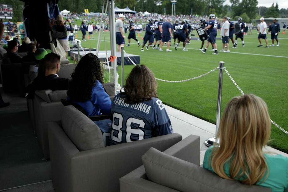 Seahawks fans watch from cushy chairs in a VIP tent. Photo: AP