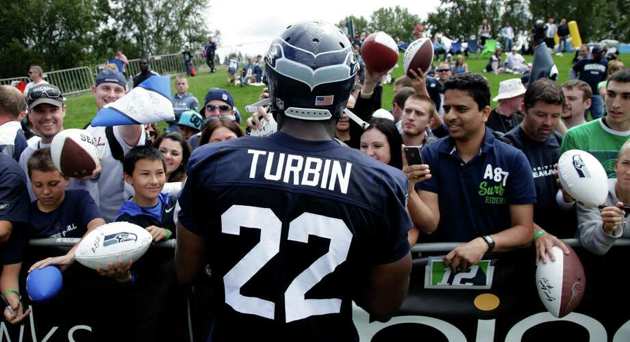 Fans get autographs from Seahawks' Robert Turbin. Photo: AP