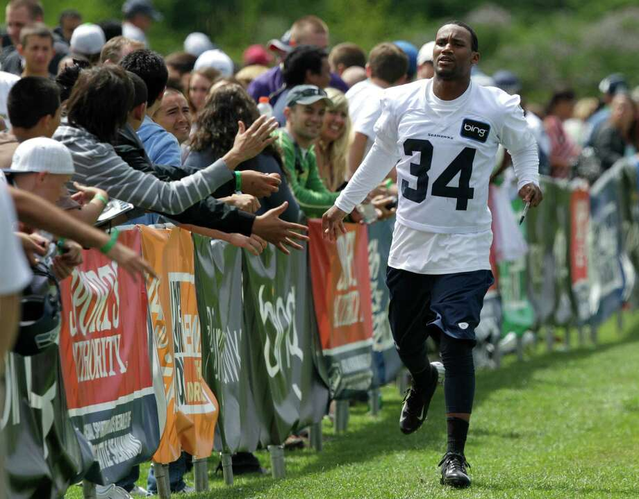Seahawks cornerback Roy Lewis greets fans. Photo: AP