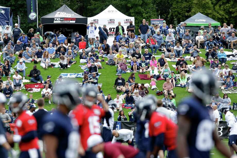 Fans watch the first day of Seahawks NFL football training camp. Photo: AP