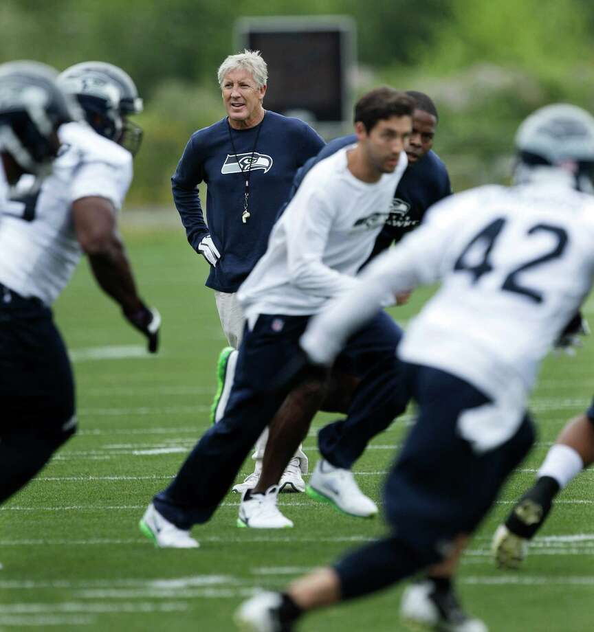 Seahawks head coach Pete Carroll observes the first day of NFL football training camp. Photo: AP