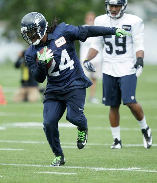 Seahawks running back Marshawn Lynch carries the ball.