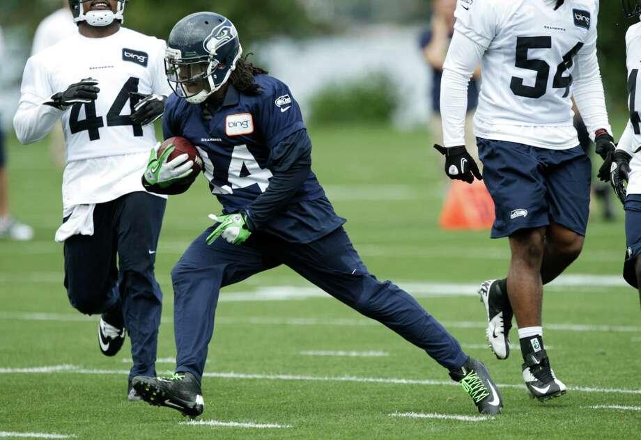 Seahawks running back Marshawn Lynch carries the ball. Photo: AP