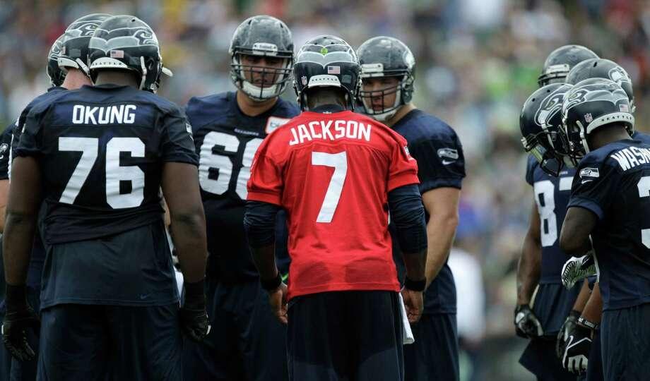 Seahawks quarterback Tavaris Jackson talks to players. Photo: AP