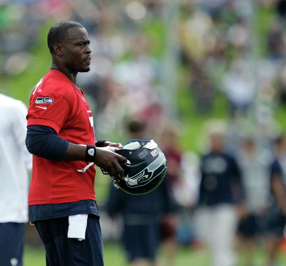 Seahawks quarterback Tavaris Jackson holds his helmet. Photo: AP