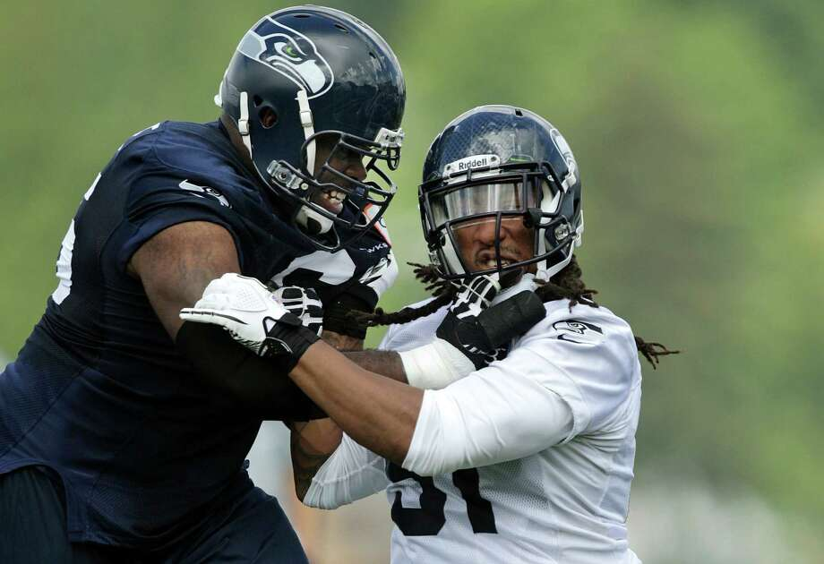 Seahawks defensive end Bruce Irvin, right, is blocked by tackle Frank Omiyale. Photo: AP