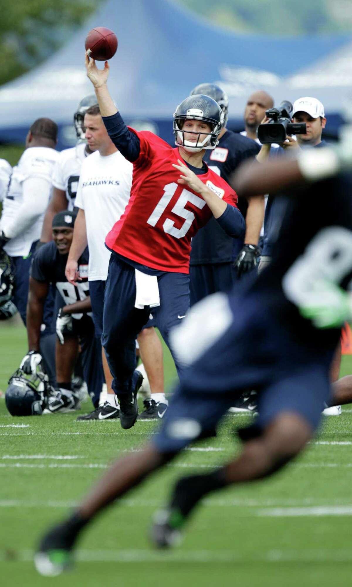 Seahawks quarterback Matt Flynn (15) passes.