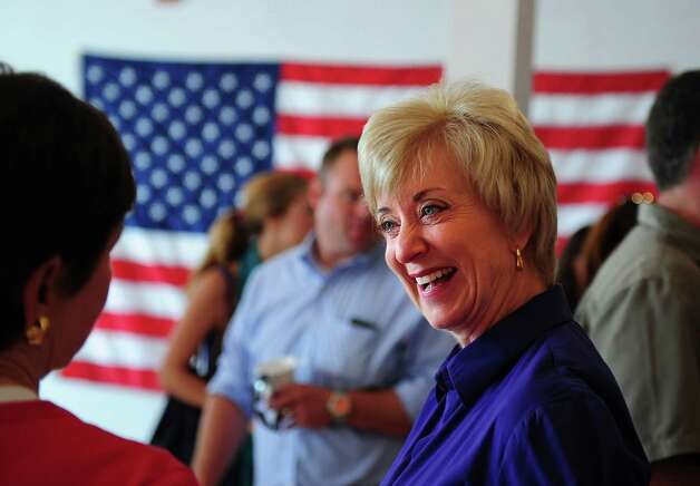 "Republican U.S. Senate candidate Linda McMahon talks with state Rep. Livvy Floren, R-149th District, at the campaign's Norwalk field office July 14, 2012, during her ""Super Saturday"" blitz, an outreach initiative with the goal of making 10,000 phone calls and knocking on 10,000 doors in a single day. Photo: Autumn Driscoll / Connecticut Post"