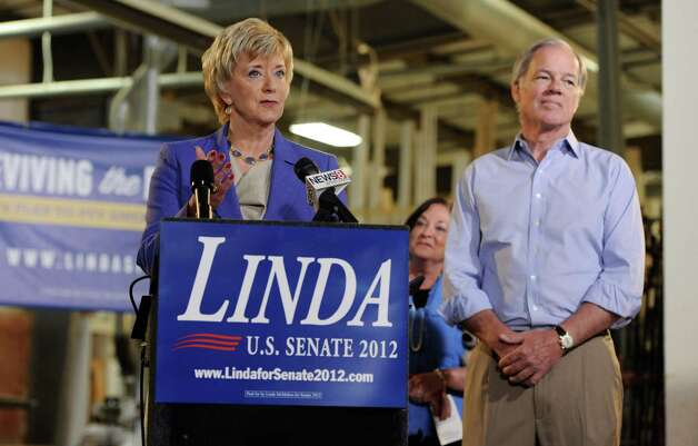 Republican Senate hopeful Linda McMahon, left, speaks as former Connecticut Republican gubernatorial candidate Tom Foley, right, listens, during her first news conference since announcing her second bid for U.S. Senate in Newington, Conn., March 14, 2012. (AP Photo/Jessica Hill) Photo: Jessica Hill, Associated Press / AP2012