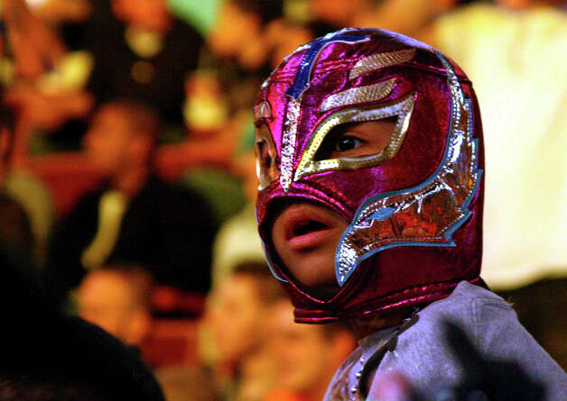 Aran Cruz, 7, of Poughkeepsie, N.Y., watches the wrestling action during WWE's Smackdown event at Mohegan Sun in Uncasville, Conn, April 20, 2010. The mask Aran is wearing is of his favorite masked wrestler, Rey Mysterio. Photo: Christian Abraham, ST / Connecticut Post no sale