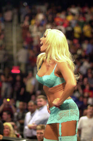 WWE Diva Torrie Wilson accompanied wrestler Tajiri out into the ring and served as a distration so he could gain the upper hand in a match in 2002 in Bridgeport. Photo: File Photo / Greenwich Time File Photo