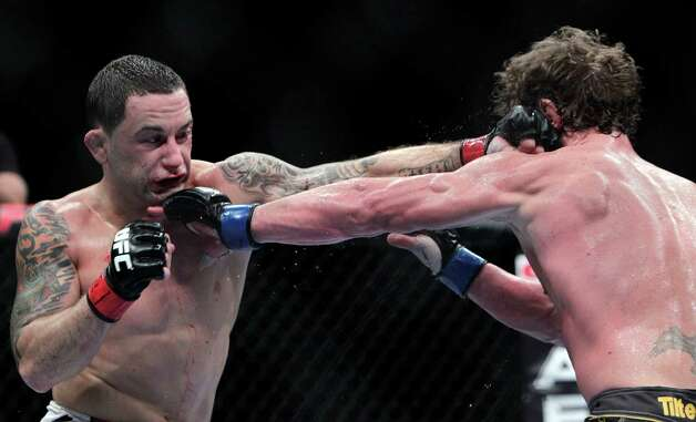 "Frankie ""The Answer""  Edgar, right, fights Gray ""The Bully"" Maynard in the during the UFC 136 lightweight title bout at Toyota Center Saturday, Oct. 8, 2011, in Houston.  Edgar knocked out Maynard in the fourth round. Before tonight Edgar's MMA record was 13-1-1 and 8-1-1 in UFC. Maynards MMA record was 11-0-1 and 8-0-1 in UFC ( Johnny Hanson / Houston Chronicle ) Photo: Johnny Hanson, Houston Chronicle / © 2011 Houston Chronicle"