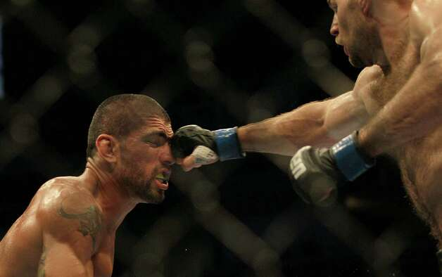 Daniel Stittgen, right, punches Marcelo Guimaraes, from Brazil, during a UFC on Fuel 4 Mixed Martial Arts welterweight bout in San Jose, Calif., Wednesday, July 11, 2012. Stittgen won by split decision. (AP Photo/Jeff Chiu) Photo: Jeff Chiu, Associated Press / AP