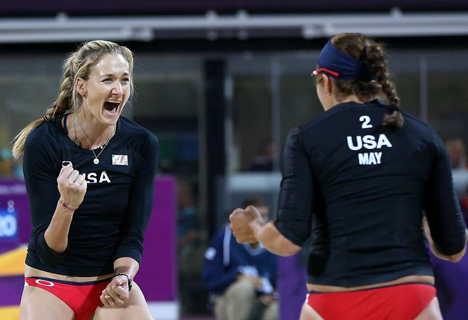 Misty May-Treanor, right, and Kerri Walsh, left, of US celebrate winning a point against Australia in their Beach Volleyball match at the 2012 Summer Olympics, Saturday, July 28, 2012, in London. (AP Photo/Petr David Josek) Photo: Petr David Josek, Associated Press