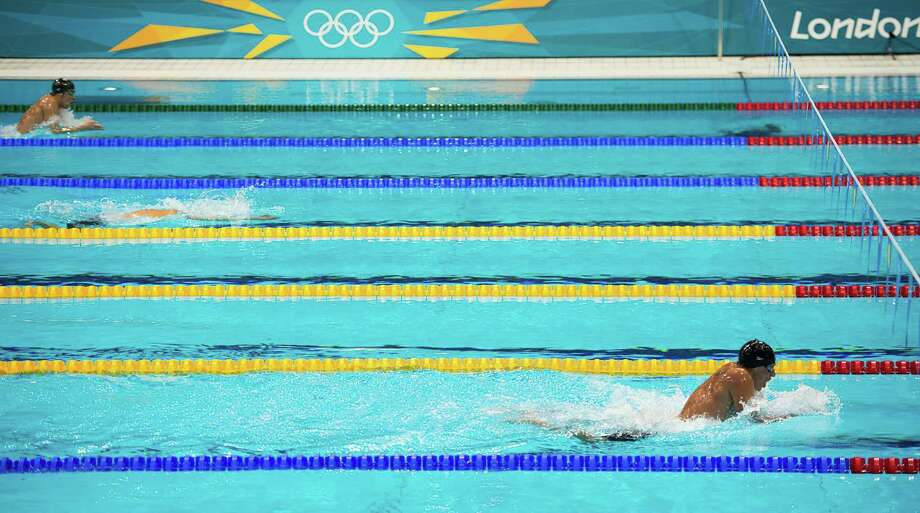 US swimmer Ryan Lochte, bottom, swims well ahead of Michael Phelps, top, during the breast stroke leg of the 400 IM at the 2012 London Olympics on Saturday, July 28, 2012. ( Smiley N. Pool / Houston Chronicle) Photo: Smiley N. Pool / © 2012  Houston Chronicle