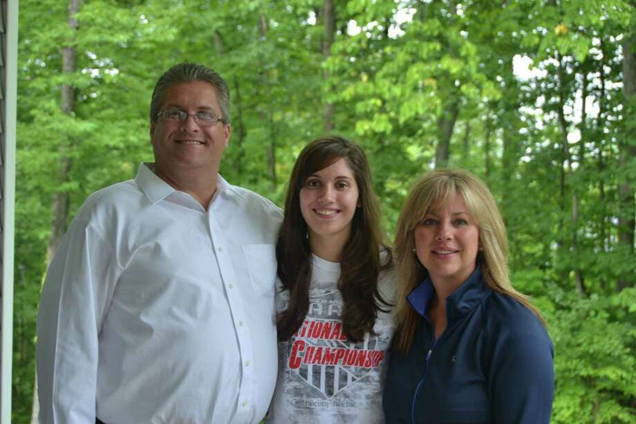 Scotia's Cassie Broadhead, center, with her father, Tim, left, and mother Nicole. (Courtesy Broadhead family)