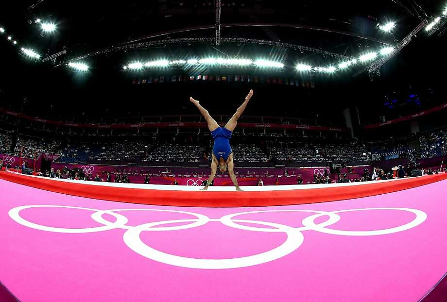 LONDON, ENGLAND - JULY 28:  John Orozco of the United States competes in the floor exercise in the Artistic Gymnastics Men's Team qualification on Day 1 of the London 2012 Olympic Games at North Greenwich Arena on July 28, 2012 in London, England.  (Photo by Ronald Martinez/Getty Images) Photo: Ronald Martinez, Getty Images