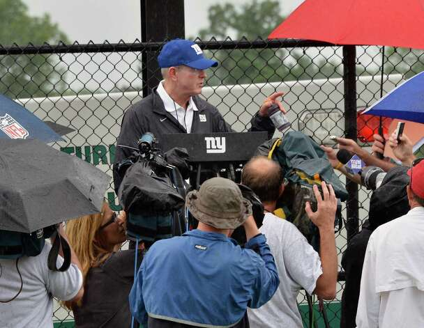 New York Giants head coach Tom Coughlin speaks to the media during training camp at UAlbany Saturday July 28, 2012.   (John Carl D'Annibale / Times Union) Photo: John Carl D'Annibale / 00018615A