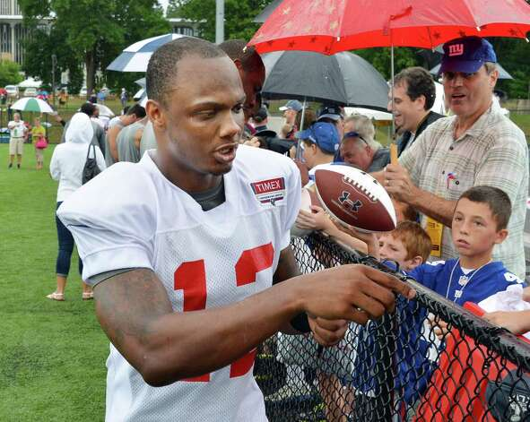 New York Giants's #12 Jerrel Jernigan signs autographs during training camp at UAlbany Saturday July 28, 2012.   (John Carl D'Annibale / Times Union) Photo: John Carl D'Annibale / 00018615A