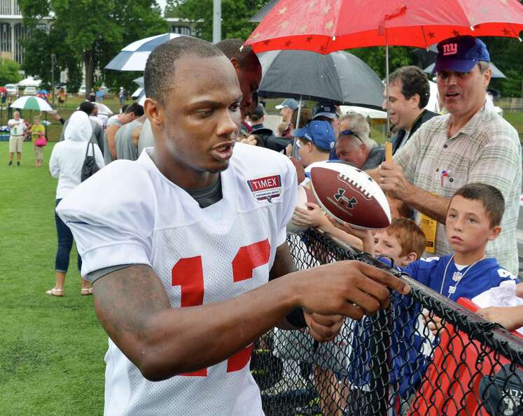 New York Giants's #12 Jerrel Jernigan signs autographs during training camp at UAlbany Saturday July
