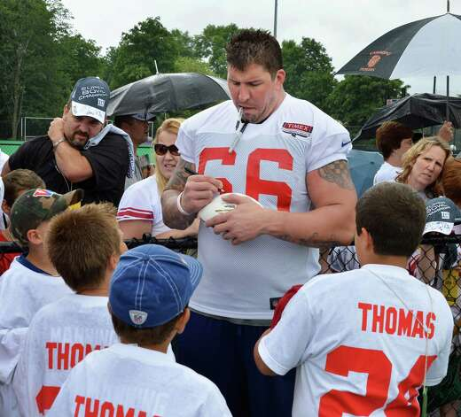 New York Giants's #66 David Diehl signs autographs during training camp at UAlbany Saturday July 28, 2012.   (John Carl D'Annibale / Times Union) Photo: John Carl D'Annibale / 00018615A