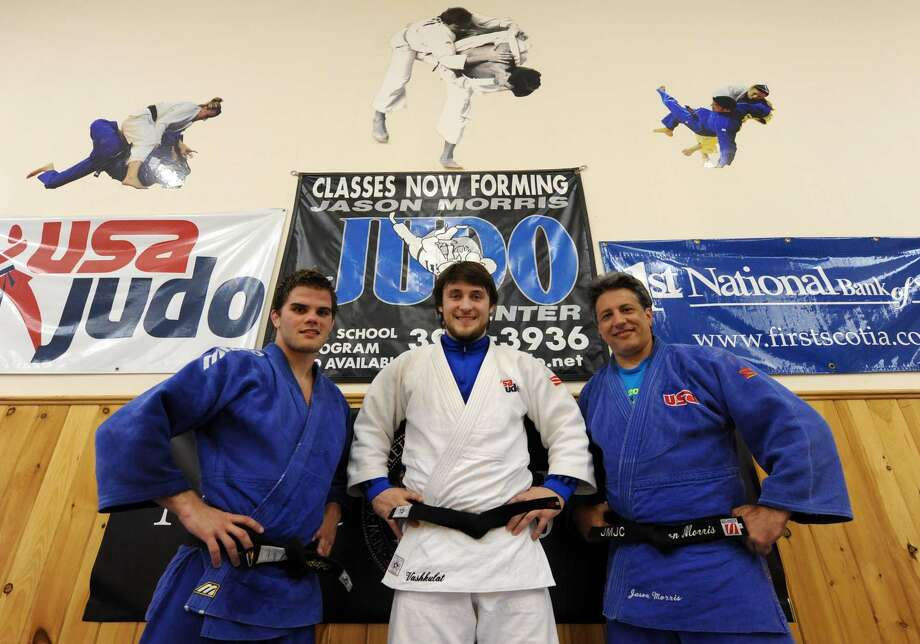 Two Olympic bound Judo competitors Nick Delpopolo, left, Kyle Vashkulat, center, with coach Jason Morris, a silver medalist in Judo in the 1992 summer Olympics,at the Jason Morris Judo Club in Glenville NY Tuesday July 17, 2012. (Michael P. Farrell/Times Union) Photo: Michael P. Farrell