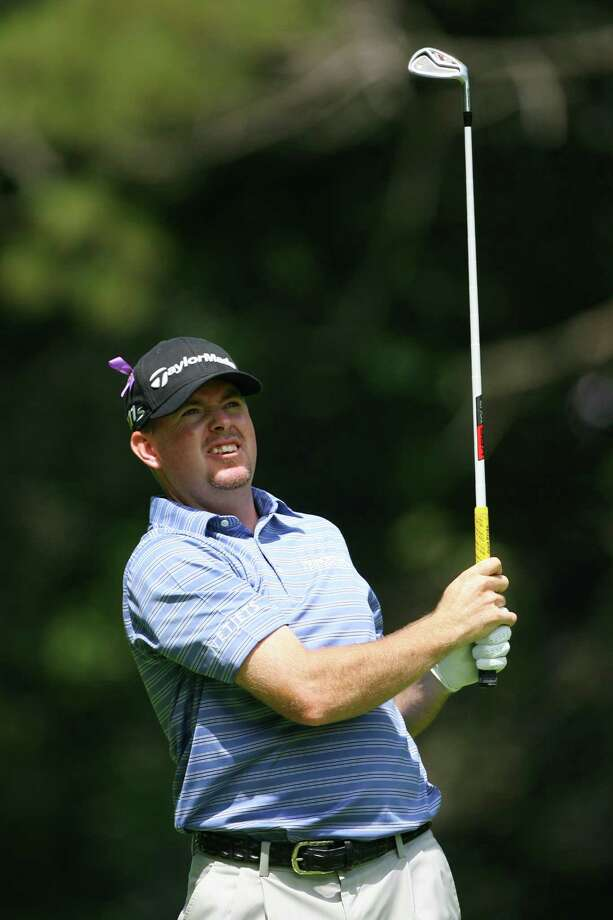 ANCASTER, CANADA - JULY 28: Robert Garrigus of the U.S. watches his second shot on the third hole during the third round of the RBC Canadian Open at Hamilton Golf and Country Club on July 28, 2012 in Ancaster, Ontario, Canada. (Photo by Hunter Martin/Getty Images) Photo: Hunter Martin