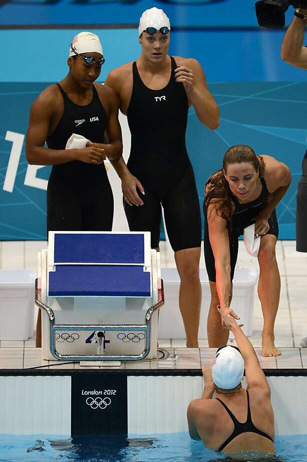 US swimmers Lia Neal, Amanda Weir, Natalie Coughlin and Allison Schmitt react after they competed in the women's 4 x 100m freestyle relay heats swimming event at the London 2012 Olympic Games on July 28, 2012 in London.  AFP PHOTO / CHRISTOPHE SIMONCHRISTOPHE SIMON/AFP/GettyImages Photo: Christophe Simon, AFP/Getty Images